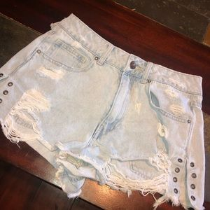 Light colored denim DIY shorts.